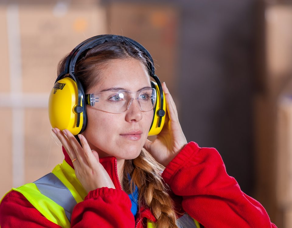 Security Woman at Manufacturing plant wearing goggles and supervising industrial staffing services