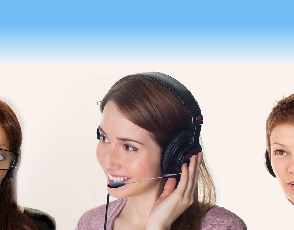 Office workers talking on headset. Staffing Service. Positive customer service.