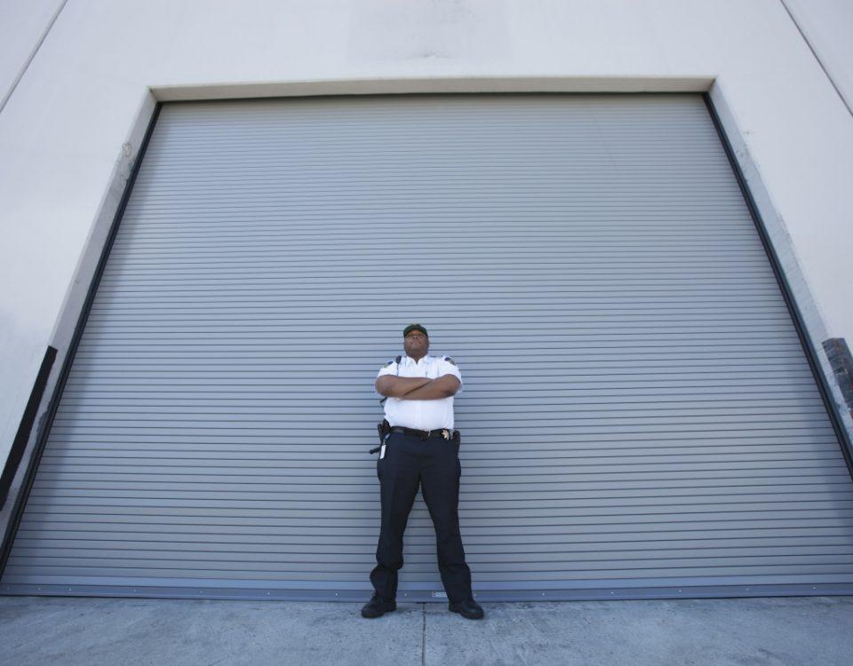 Security Guard in front of garage door.